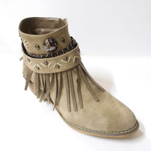 Tan/beige ankle booties with fringe design and embellished strap upper. Suede-like material. Slight heel. Decorated upper with a chain, embellished strap, and fringe. Inner side-zipper.