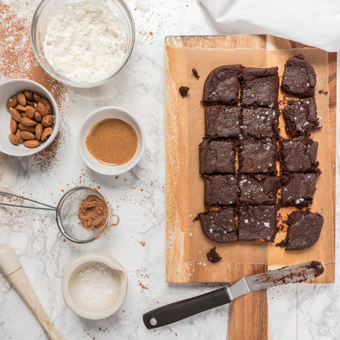 brownies on a wooden tray with ingredients on the side