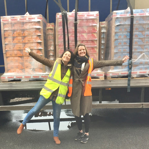 charlotte and kim and a big lorry full of boxes of cookies