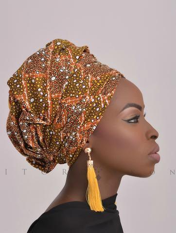 Mustard tassel earrings by Itoro Okon