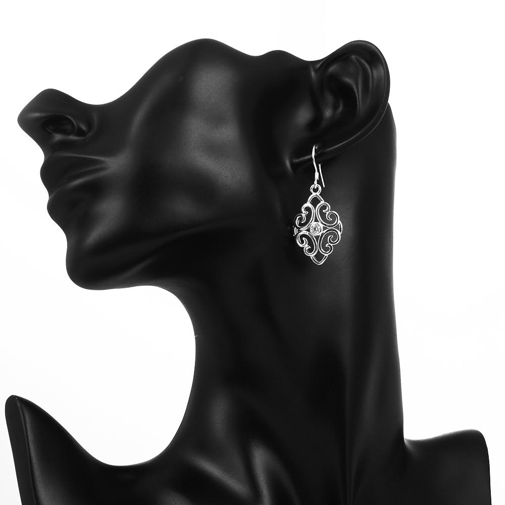 White gold plated earring with a Swarovski crystal in each on a mannequin.