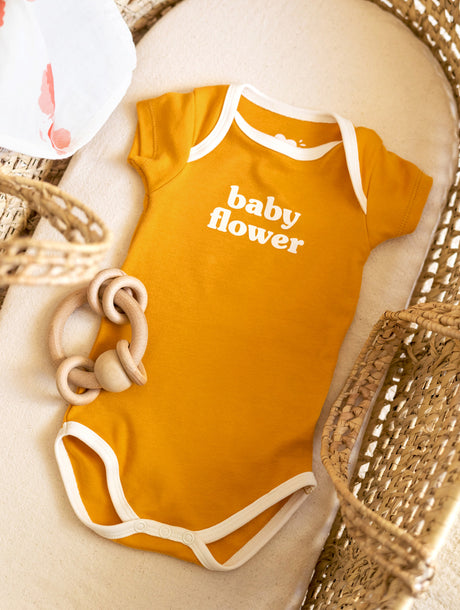 Le body Baby flower en coton bio - mangue
