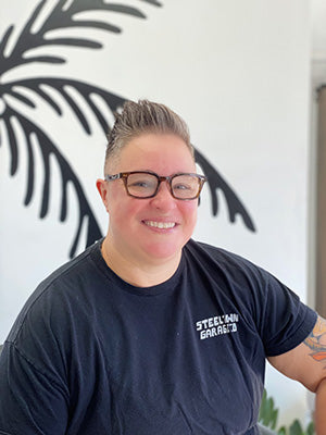 A headshot of Good Hair Co barber Lilly