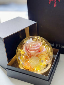 Preserved rose in round bottle with LED light
