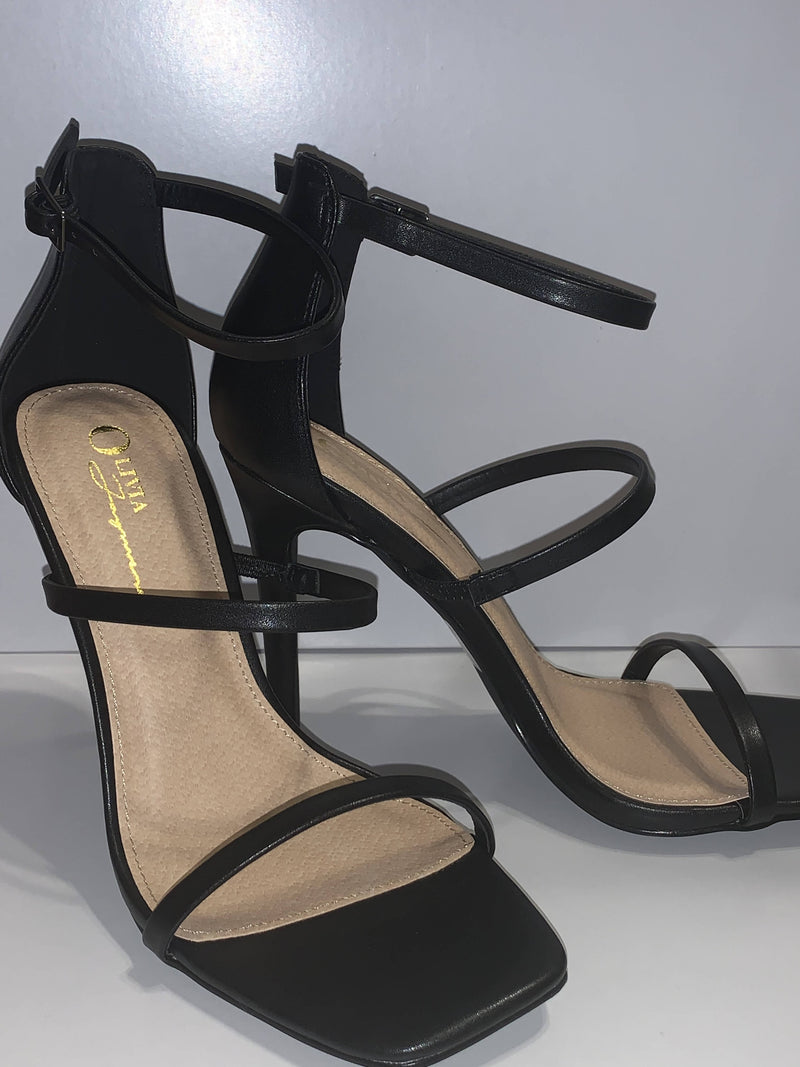 Black leather heels with ankle strap