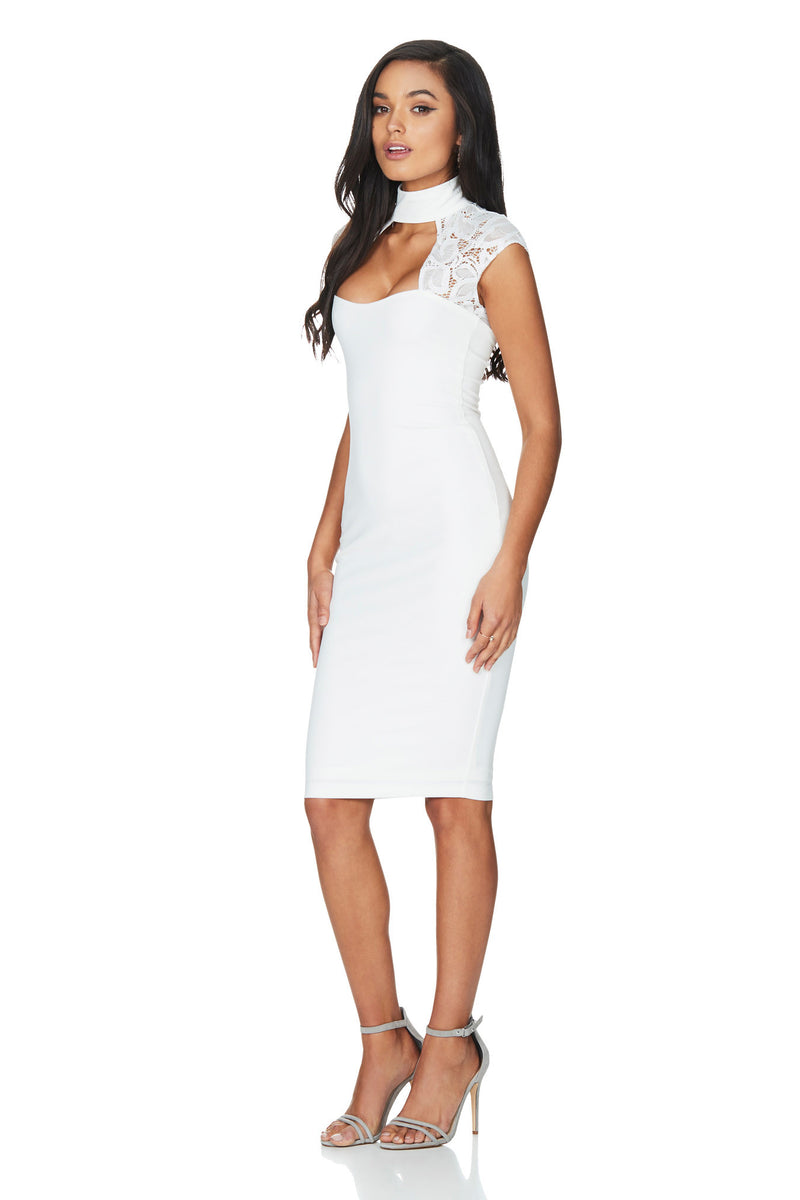 A Nookie Dress, side view of the Lady Lace Midi Dress in white.