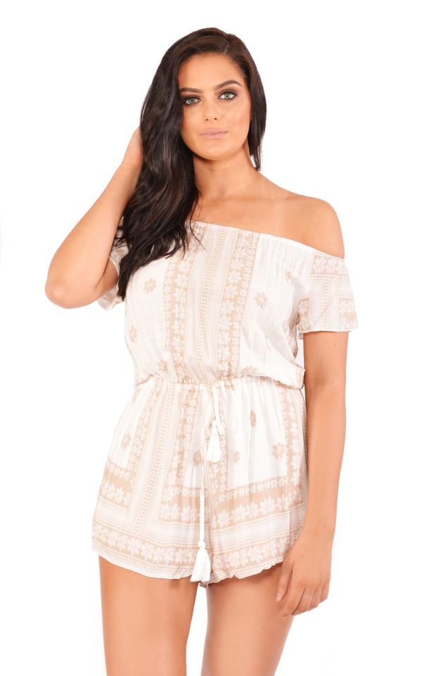 Reverse Official playsuit, cropped front view of the Pleasures Playsuit in white print.
