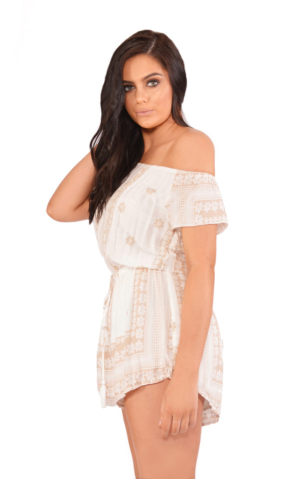 Reverse Playsuit, side view of the Pleasures Playsuit in white print.