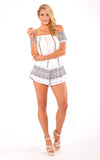 Reverse playsuit, front view of the True Love off the shoulder playsuit.