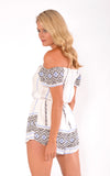 Reverse playsuit, side rear view of the True Love Playsuit in white print.