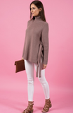 Style State sweater, full view of taupe turtleneck sweater with side ties.