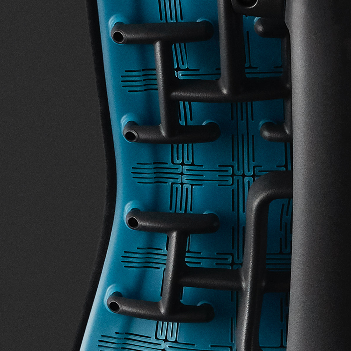 Embody Gaming Chair close-up of cyan matte back and spine with a black background.