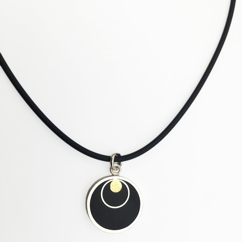 Black Circles and Brass Pendant