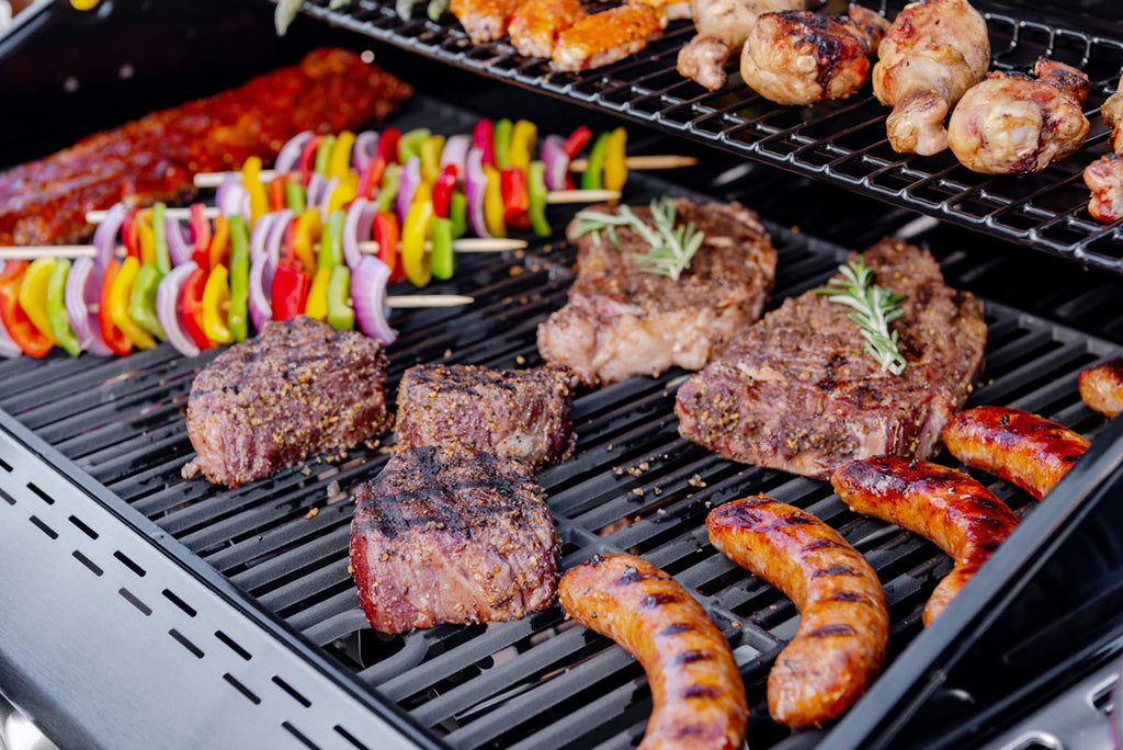 food cooking on a gas grill