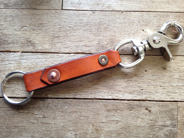 12 gauge key chain / carrier shown in saddle tan and all nickel hardware