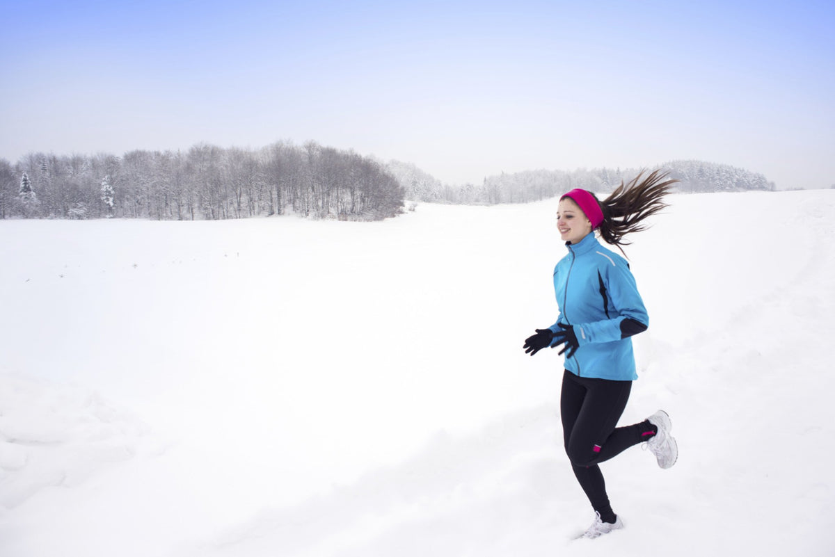 A female athlete running in the cold