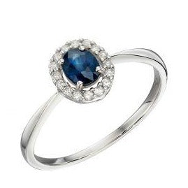 White gold cluster ring with diamonds and blue sapphire stone