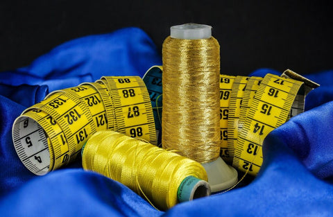 Sewing thread and tape rule