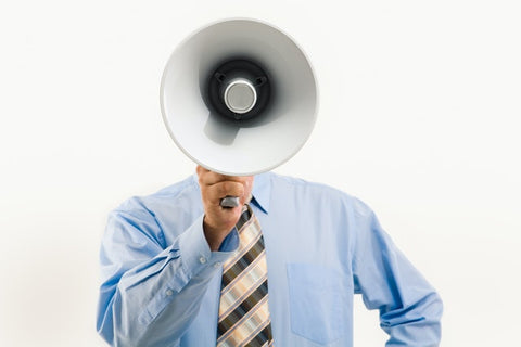 Generating more sales as a small business. man holding a megaphone