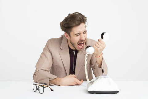 Generating more sales as a small business. man shouting on the phone - a bad way of generating sales