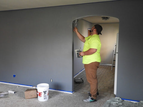 Home based business.Man painting