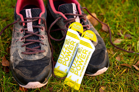 Image of Buzz Power natural energy gel and muddy running shoes