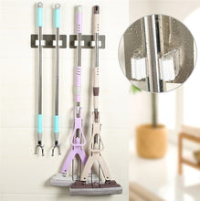 Load image into Gallery viewer, Organise your cleaning supplies with our wall mounted mop organiser holder