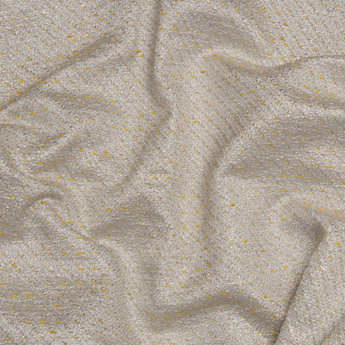 Metallic yellowish fabric. Cotton gives the suavity needed for inside comfort being suitable for lovely jackets, but also for showy dresses or skirts...