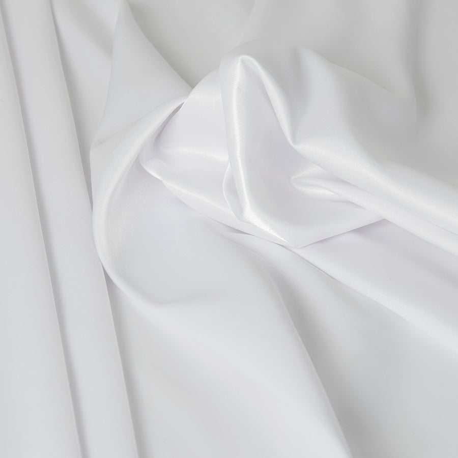 Stretchable satin in white color, perfect for sophisticated summer clothes. Super trendy for tops and blouses but also usable for richest linings.