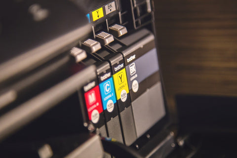image of a printer with it's sustainable refillable ink cartridges exposed