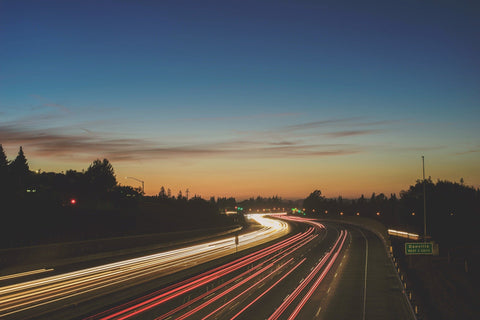 image of a motorway with timelapse vehicles for offset eco friendly delivery
