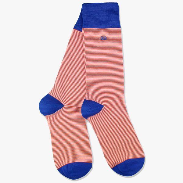 orange mens striped socks on white background