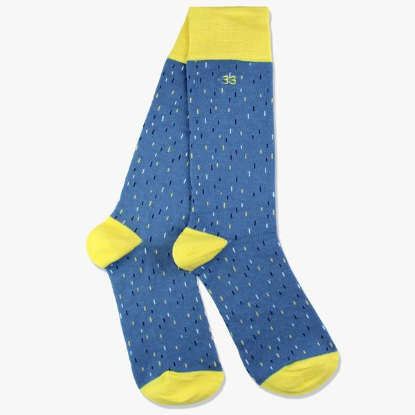 blue socks with yellow heel and funky pattern