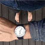 Load image into Gallery viewer, Man wearing denim shirt with blue strap watch