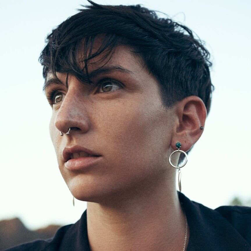 woman with multiple nose and ear piercings
