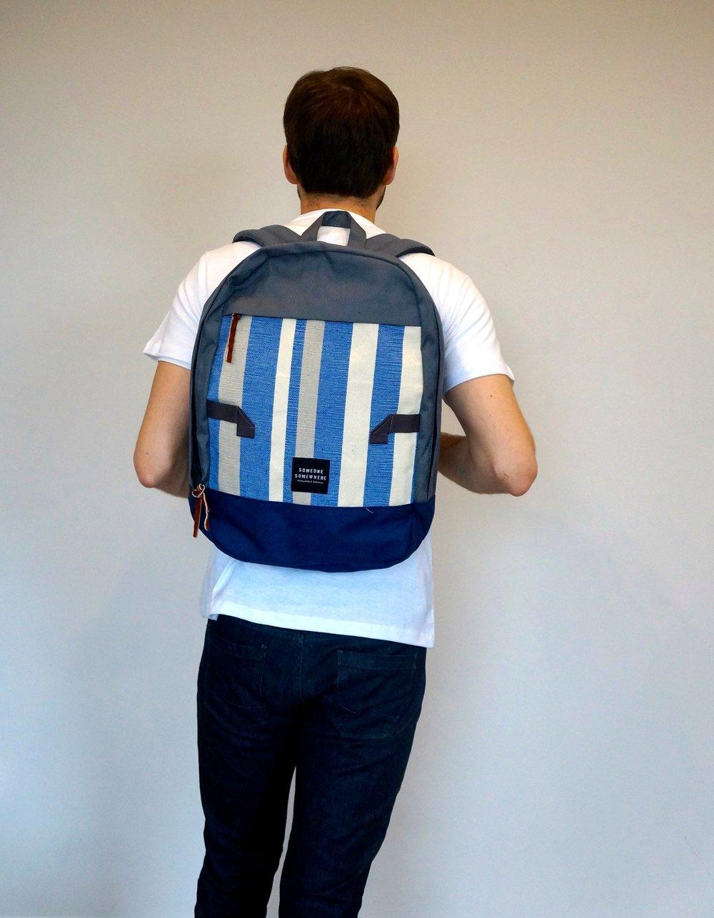 model wearing blue and white someone somewhere backpack