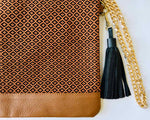 Load image into Gallery viewer, brown artisan bag with handmade textile detailing, gold chain and black tassle