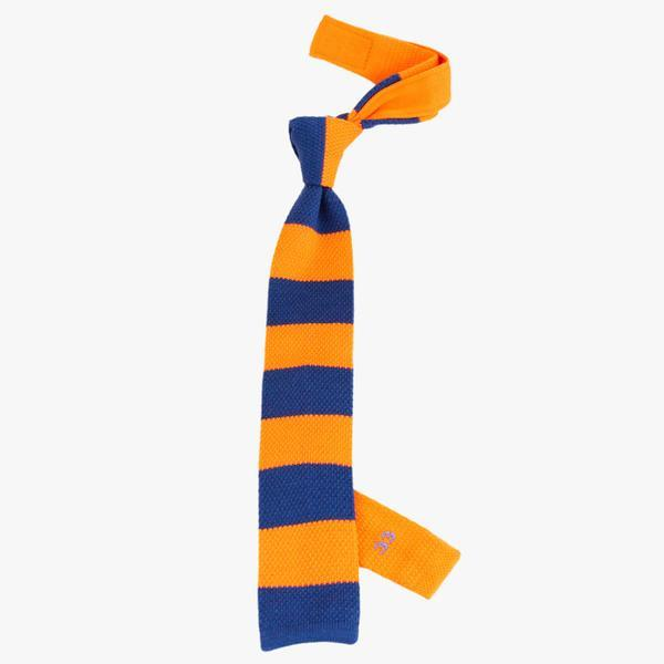woven rugby tie blue and yellow with knot on white background