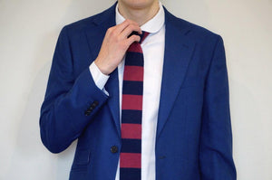 model wearing white shirt with woven blue and red tie