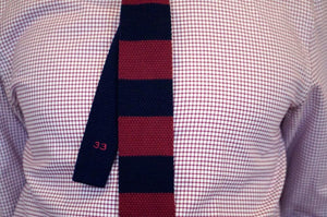 formal shirt with navy and red skinny tie