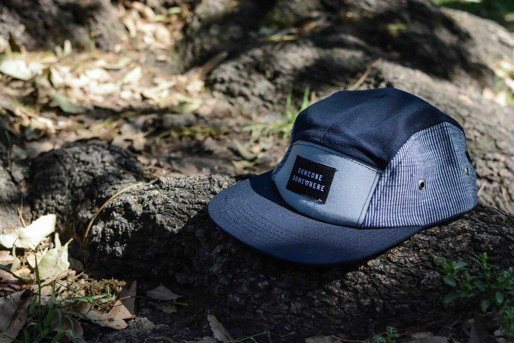 blue someone somewhere handmade cap with forest background