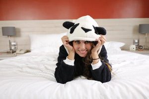 girl wearing panda onesie with fluffy hood and ears