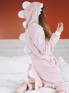 pink dinosaur onesie with white tail and fluffy hood