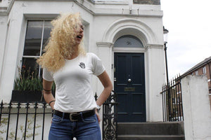 girl in london wearing small white slogan t-shirt