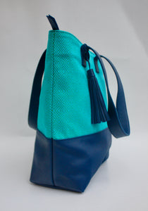 Side view of blue Mexican embroidered women's handbag