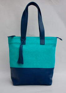Blue leather handbag with tassle and embroidered turquqise pattern
