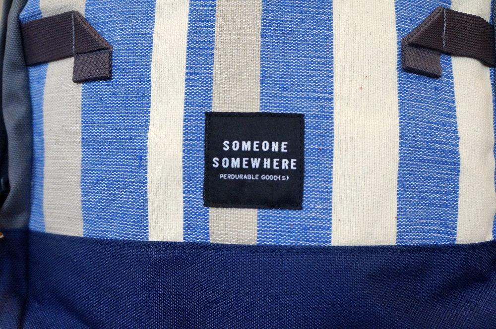 closeup of someone somewhere logo and blue weave