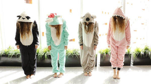 women wearing panda, koala, dinosaur and unicorn onesies in the house