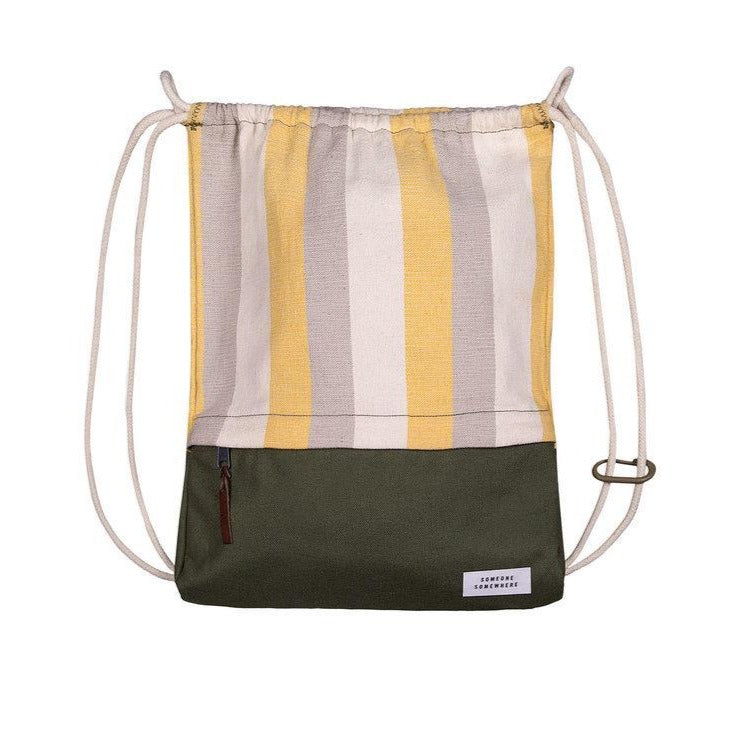 Green, yellow and white drawstring back with someone somewhere branding