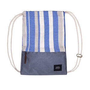 Blue, white and grey drawstring bag with someone somewhere logo